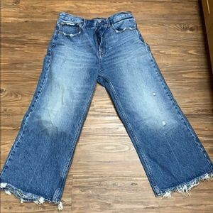 Cropped flare jeans with distressed hem